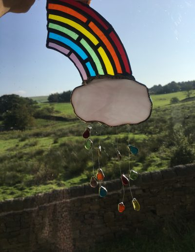Stained glass half rainbow and cloud sun catcher