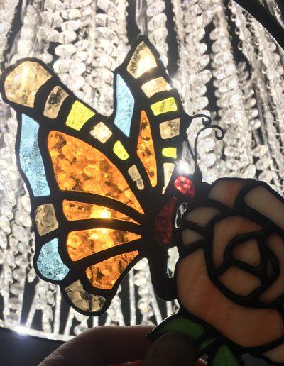 Butterfly on a rose sun catcher