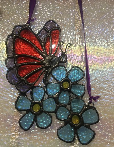 Butterfly on Forget-me-Not Flowers Sun Catcher
