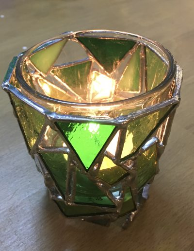 Green glass tea light holder