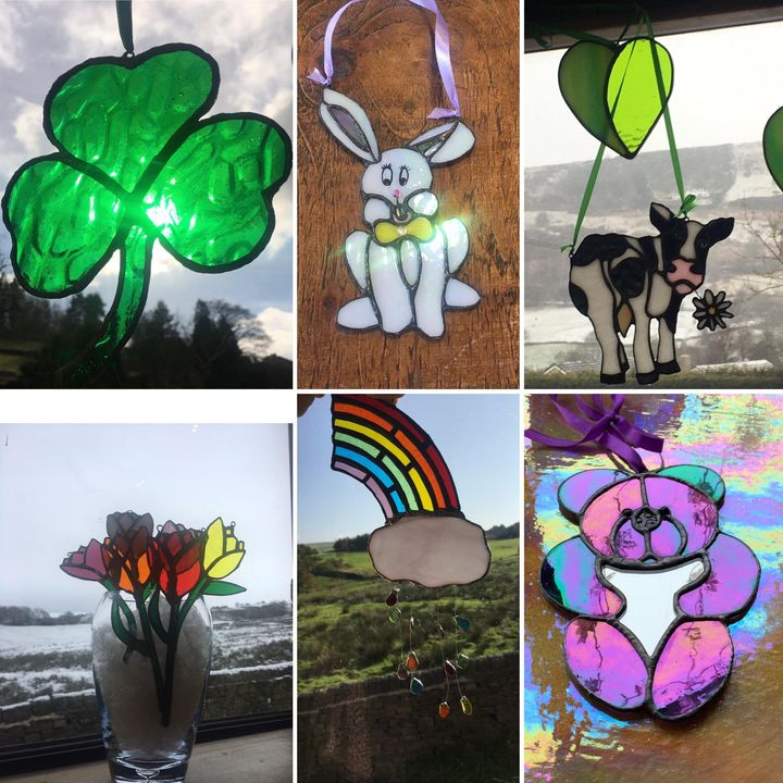 Images of teddy bear sculpture butterfly sunflower hand tulips rainbow and poppy sun catchers