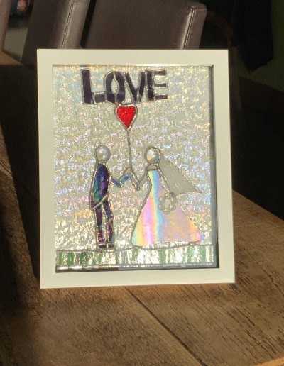 Bride and groom in stained glass