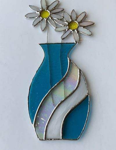 Stained glass vase of daisies