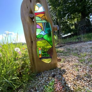 Stained glass and wood sculpture