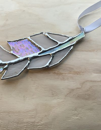 White stained glass feather sun catcher