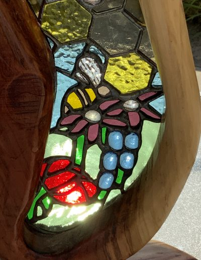 Bees and flowers stained glass and wood sculpture