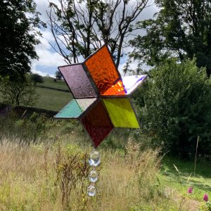 Coloured stained glass spinner