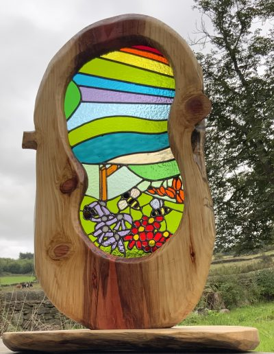 Colourful stained glass and wood sculpture