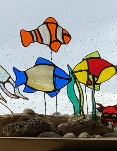 Stained glass fish and driftwood