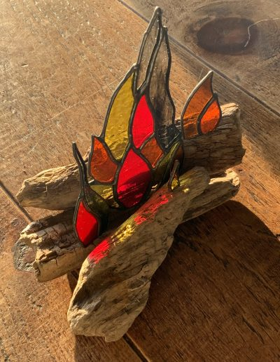 Stained glass fire on driftwood